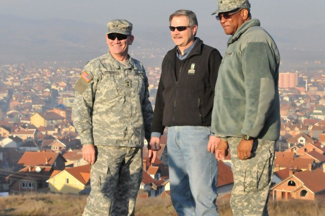 Gov. John Hoeven, Governor, North Dakota, Maj. Gen. David A. Sprynczynatyk, adjutant general, North Dakota National Guard, and Brig. Gen. Renaldo Rivera, Adjutant General, Virgin Islands National Guard, pose for a picture at a memorial site overlooking Gnjilane/Gjilan, Kosovo.  Hoeven and Sprynczynatyk both recently completed visits to North Dakota Soldiers, while Rivera visited with Virgin Islands Soldiers, deployed to Camp Bondsteel, Kosovo for a NATO peacekeeping mission.