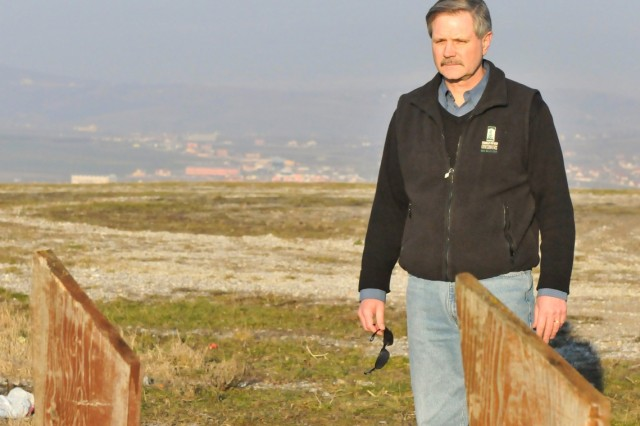 Gov. John Hoeven, Governor, North Dakota, takes a moment at a memorial site overlooking Gnjilane/Gjilan, Kosovo.  Hoeven recently completed a visit to North Dakota Soldiers deployed to Camp Bondsteel, Kosovo for a NATO peacekeeping mission.