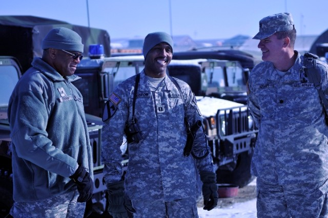Brig. Gen. Renaldo Rivera, adjutant general of the Virgin Islands National Guard, Capt. Arthur Hector, commander of the 661st Military Police Co., and Lt. Col Ova O'Hair have a laugh during Brig. Gen. Rivera's recent visit to Camp Bondsteel, Kosovo. About 100 Soldiers from the Virgin Islands are currently deployed to Camp Bondsteel as part of Kosovo Forces (KFOR) 12 Multi-National Battle Group-East.