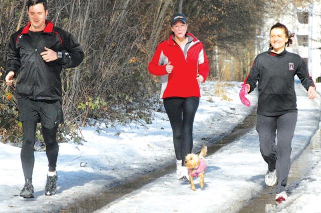 """Students"" Trent Minter (L to R), Eileen Godinez, School of Marathon coach Angi Buckley and dog, Porsche, complete a 6-mile run Feb. 4."