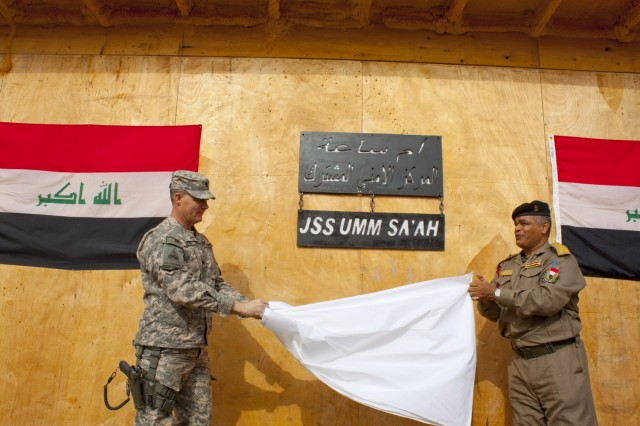 Task Force Saber Commander Lt. Col. William Walski and Brig. Gen. Razzak, 11th Iraqi Department of Border Enforcement commander, unveil the Joint Security Station Umm Sa'ah name plate Feb. 4, 2010. 2nd Squadron, 13th Cavalry Regiment is deployed from Fort Bliss, Texas to southern Iraq to advise and assist Iraqi Security Forces.