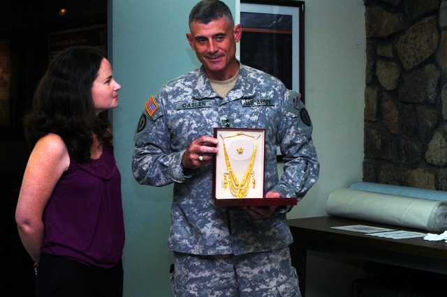 BodyMaj. Gen. Robert L. Caslen Jr., commanding general, 25th Infantry Division, holds a gold necklace and earring set presented to him in Iraq for his wife Shelly, before donating it to the Tropic Lightning Museum, Feb. 4. (U.S. Army photo by Spc. Mahlet Tesfaye, 25th Infantry Division Public Affairs Office).