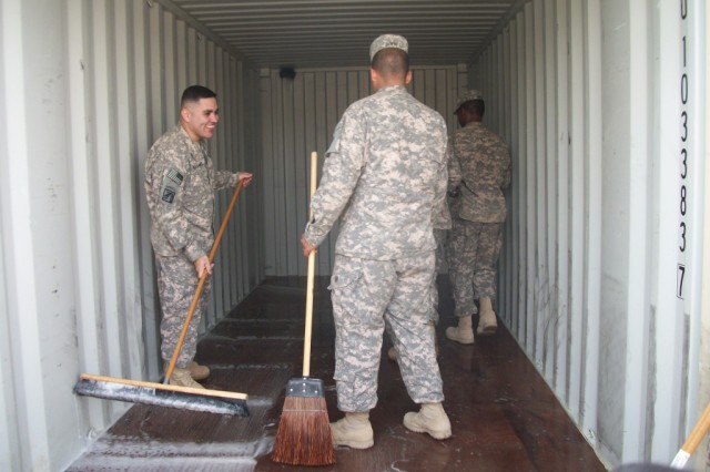 Sgt. Adrian Doerfer, a human resources noncommissioned officer from Colorado Springs, Colo., Sgt. Jeffrey Spicer, a unit supply sergeant from Miami, Fla., and Staff Sgt. Alexander Munoz, an automated logistical specialist, Armenia, Columbia all lead from the front by showing Soldiers that cleaning can also be fun.