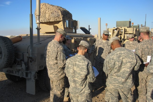 Sgt. First Class Warren Woodards, communications section noncommissioned officer in charge from Willingboro, N.J. continues to walk a class through the proper preventive maintenance checks and services of the vehicle mounted radio.