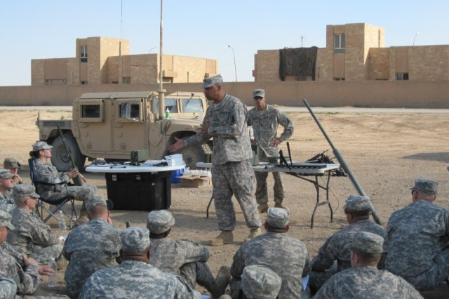 Sgt. 1st Class Warren Woodards, communications section noncommissioned officer in charge from Willingboro, N.J., reinforces the key points of radio parts and procedures to the class.