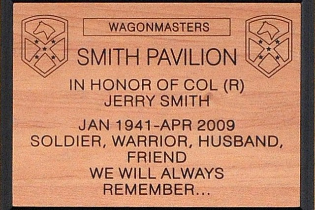 "The plaque that hangs on Smith Pavilion at Contingency Operating Location Q-West, Iraq reads ""Soldier, warrior, husband, friend. We will always remember ...."" (U.S. Army photo by Staff Sgt. Rob Strain, 15th Sustainment Brigade Public Affairs)"