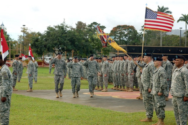 From left, Lt. Col Jerry Turner, incoming commander of 3rd Squadron, 4th U.S. Cavalry, 3rd Infantry Brigade Combat Team, 25th Infantry Division, Maj. Jeff Powell, squadron executive officer and Lt. Col. David Hodne, outgoing commander salute the American flag as they troop the line during a change of command ceremony at Sills Field Jan. 26. (U.S. Army photo by Spc. Jazz Burney, 3rd Infantry Brigade Combat Team, 25th Infantry Division Public Affairs)