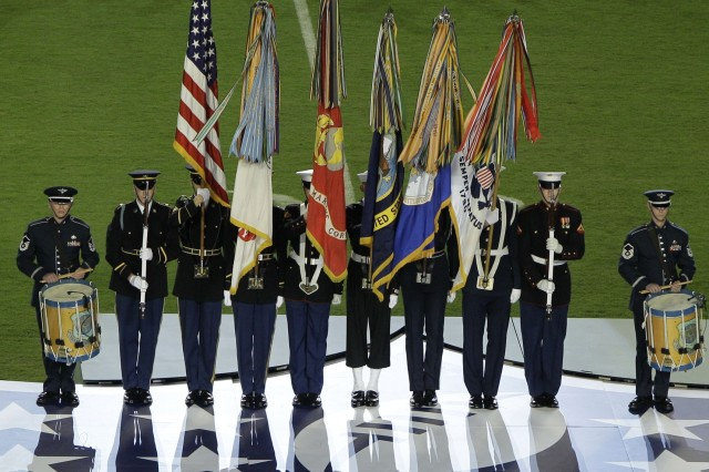 During the pregame festivities at the SuperBowl on Sunday, February 7, 2010, an Armed Forces Color Guard from the Military District of Washington presented colors while being accompanied by drummers from the U.S. Air Force Band.