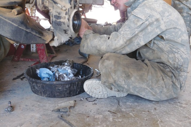 A B Co., 46th Eng. Bn., Soldier works on a vehicle while deployed last year to Iraq. After about 40 years here, the unit deactivated Wednesday.