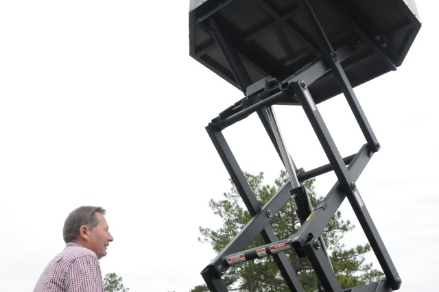Mark Yoakum, Fort Rucker ODR facilities manager, operates a handicapped tree stand the organization received in January. The stand allows handicapped hunters to shoot from up to 18 feet off the ground.