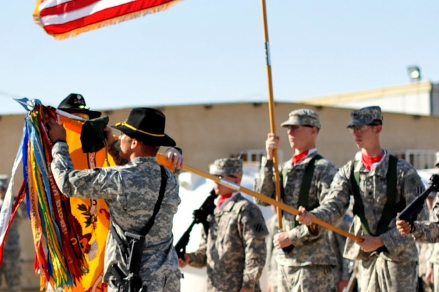 5th Squadron, 7th Cavalry Regiment, 1st Brigade Combat Team-Augmented Commander Lt. Col. Kirk Dorr and Command Sgt. Maj. William Transue, unfurl their unit Colors during a ceremony marking the troopers taking command of their own area of responsibility in Iraq at FOB Falcon, Jan 22.
