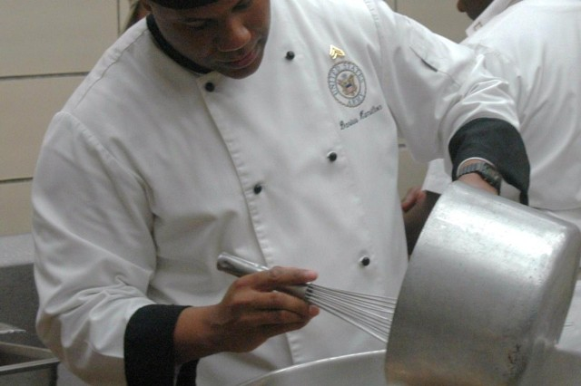"""FORT POLK, La. - Sgt. Darius Hamilton, food service specialist, Company F, Forward Support Company, 2nd Battalion 30th Infantry stirs potatoes while preparing meals for an """"Iron Chef"""" competition in Patriot Inn dining facility, Jan. 29."""