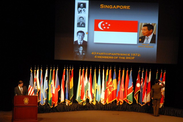 Maj. Wei Yee Choo of Singapore salutes his country's flag during the opening day ceremony for Command and General Staff College Intermediate Level Education 2010-02 class Feb. 8, at Eisenhower Auditorium, Fort Leavenworth, Kan.