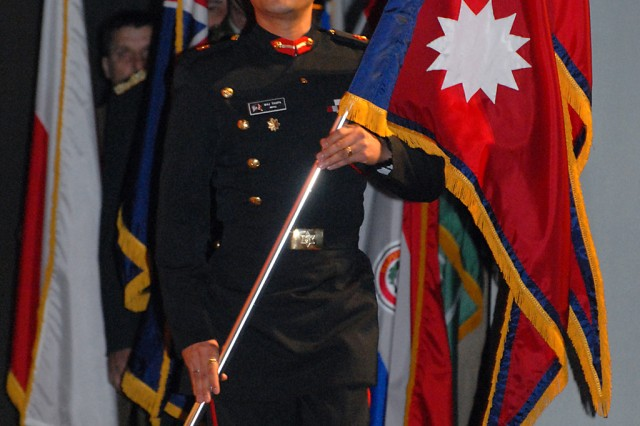 Maj. Renjit Thapa of Nepal lines up with other international students for the international flag ceremony signifying opening day for Command and General Staff College Intermediate Level Education 2010-02 class Feb. 8, at Eisenhower Auditorium, Fort Leavenworth, Kan.