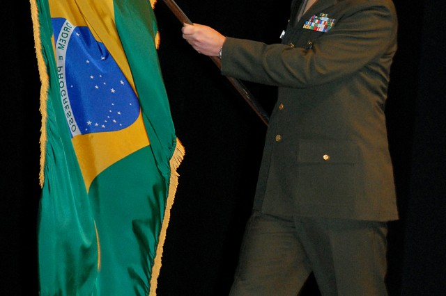 Brazilian Maj. Washington Triani, an international student in the Command and General Staff College Intermediate Level Education 2010-02 class, crosses the stage to post his country's flag during the international flag ceremony Feb. 8, at Eisenhower Auditorium, Fort Leavenworth, Kan.