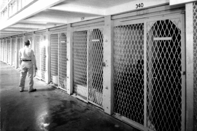 A Soldier checks cells on one of the six tiers inside the old U.S. Disciplinary Barracks at Fort Leavenworth, Kan.