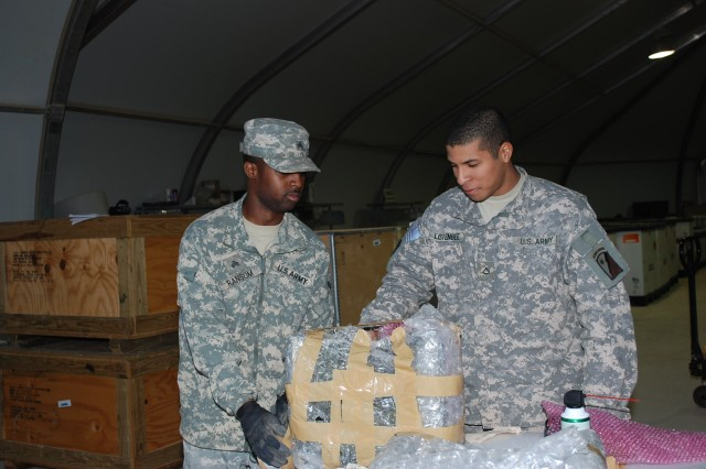 Sgt. Doron Q. Ransom and Pfc. Barrett L. Listenbee, inspectors with 249th Quartermaster Company, 2nd Battalion, 402nd Army Field Support Brigade, inspect and wrap equipment at the Joint Base Balad Redistribution Property Assistance Team yard. This equipment is being sent from Iraq to Kuwait for redistribution or back to a source of repair in the U.S.