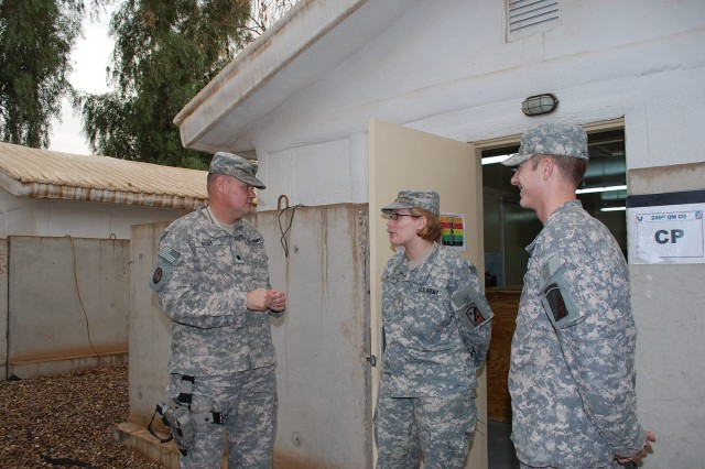 Lt. Col. Garry B. Bush, commander, 2nd Battalion, 402nd Army Field Support Brigade, talks with 2nd Lt. Renee M. McElroy, 3rd platoon leader, 249th Quartermaster Company and Capt. Matthew D. Haistings,  249th Quartermaster Company commander, at the company's headquarters at Joint Base Balad, Iraq. The 249th QM Company supports the Responsible Drawdown mission in Iraq by supplementing the 2nd Battalion's Redistribution Property Assistance Teams at fixed yards and on mobile RPATs.