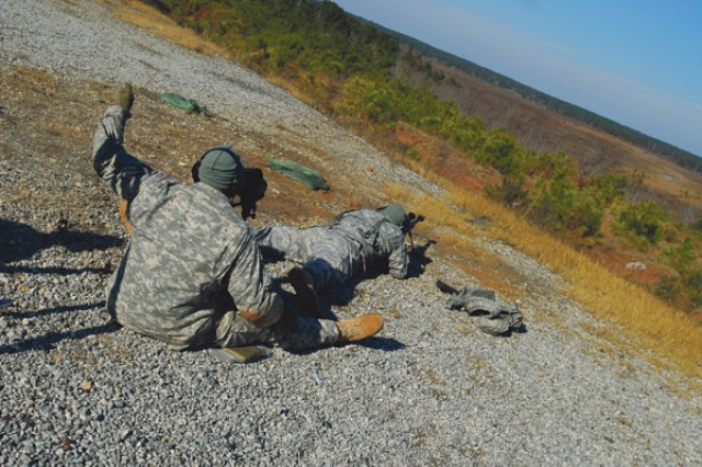 """The two-man team of SFC George Lewis and SGT Pedro Ortiz aims to hit each of 10 targets at various distances. The furthest target, a tank, is positioned more than 1,500 meters away."""""""