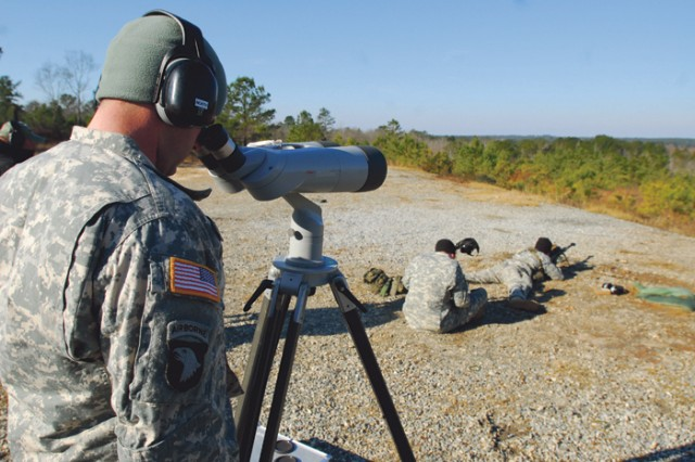 A sniper instructor tracks how many bullets hit the intended targets.""