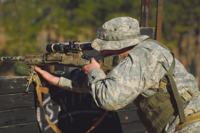 A student in his final day at the U.S. Army Sniper School takes aim Wednesday at a target 800 meters away as part of a one-day culmination event testing all of the skills the students have learned in the five-week course. ""