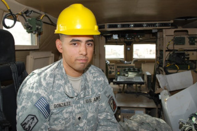 Spc. Angel C. Gonzalez, an inspector assigned to the 249th Quartermaster Company, 2nd Battalion, 402nd Army Field Support Brigade, sits in a mine-resistant ambush-protected vehicle at the Joint Base Balad [Iraq] Redistribution Property Assistance Team yard. Gonzalez is inspecting the vehicle so it can be sent from Iraq to Kuwait for redistribution or back to a source of repair in the U.S.
