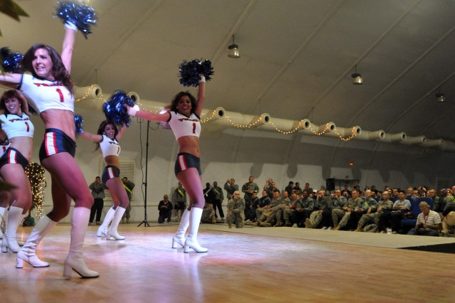 Professional football's Houston Texan cheerleaders perform for service members and civilians at the Morale Welfare and Recreation center here, Feb. 4. The women visited Soldiers of the 15th Special Troops Battalion, 15th Sustainment Brigade, 13th Sustainment Command (Expeditionary) at work before doing a few cheers, posing for photos with service members and civilians, and signing autographs. (U.S. Army photo by Sgt. Matthew C. Cooley, 15th Sustainment Brigade public affairs)