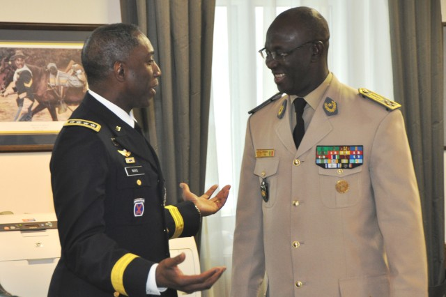 STUTTGART, Germany - Gen. William E. Ward, commander, U.S. Africa Command, talks with Lt. Gen. Abdoulaye Fall, chief of defense staff, Senegalese Armed Forces, during an office call held February 11, 2010, at Kelley Barracks. Fall is the first African defense chief to visit U.S. Africa Command (AFRICOM) headquarters. In addition the office call, Fall held briefings and discussions with other AFRICOM senior leaders. Six other senior Senegal military officials also visited the command headquarters this week to discuss security cooperation goals with the command and its service components.