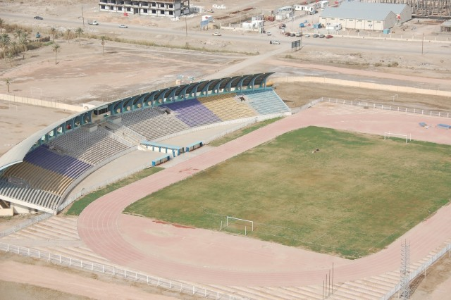 An Olympic-style soccer stadium stands as a centerpiece of the Samawa, Iraq landscape, Jan. 24, 2010. The Muthanna Provincial Reconstruction Team, with the assistance of 4th Brigade Combat Team, 1st Armored Division, helped the Provincial Investment Commission - much like a chamber of commerce - put together a flyover of the province to show potential investors a different perspective of the region.