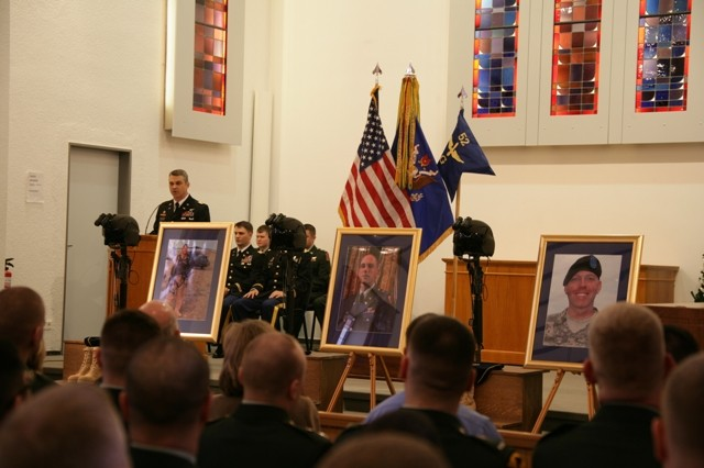 Lt. Col. Richard Watson eulogizes three of his fallen troops during a memorial ceremony held at Panzer Kaserne Community Chapel in Stuttgart, Germany, Feb. 11. Chief Warrant Officer 3 Gary M. Farwell, Chief Warrant Officer 2 Clayton M. Hickman and Cpl. Matthew E. Clark lost their lives in the crash of a UH-60 Blackhawk helicopter during an evening training mission northeast of Manheim, Germany, Feb. 3. All of the men were assigned to G Company, 52nd Regiment, 1st Battalion, 214th Aviation Regiment, 12th Combat Aviation Brigade. Watson is the commanding officer of the 1-214th Avn. Regt.