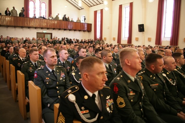 Hundreds of mourners pack the Panzer Kaserne Community Chapel in Stuttgart, Germany, Feb. 11 for a memorial ceremony honoring the lives of Chief Warrant Officer 3 Gary M. Farwell, Chief Warrant Officer 2 Clayton M. Hickman and Cpl. Matthew E. Clark. The three Soldiers lost their lives in the crash of a UH-60 Blackhawk helicopter during an evening training mission northeast of Manheim, Germany, Feb. 3. All of the men were assigned to G Company, 52nd Regiment, 1st Battalion, 214th Aviation Regiment, 12th Combat Aviation Brigade.