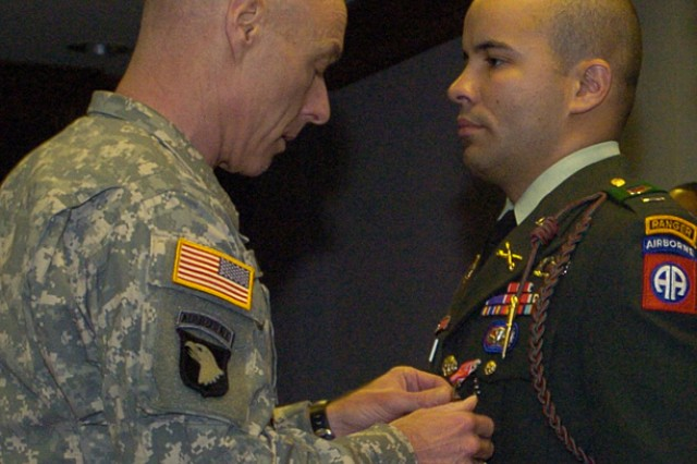 Lt. Gen. Frank Helmick, left, XVIII Airborne Corps commanding general, pins the Bronze Star with Valor  on 1st Lt. Luis Reyes, 5th Squadron, 73rd Cavalry Regiment, 3rd Brigade Combat Team, 82nd Airborne Division during a ceremony Friday.