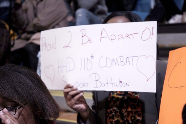 A Family member holds up a sign in support of her Soldier and the 110 CSSB.