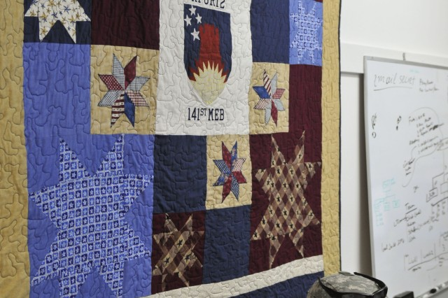 A patriotic quilt made for 1st Lt. Justin Abel, West Fargo, N.D., by his mother, Darlene Abel, Minot, N.D., is hung with pride in his office.  Abel is deployed to Camp Bondsteel, Kosovo with the North Dakota Army National Guard for a Kosovo Forces (KFOR) 12 peacekeeping mission.