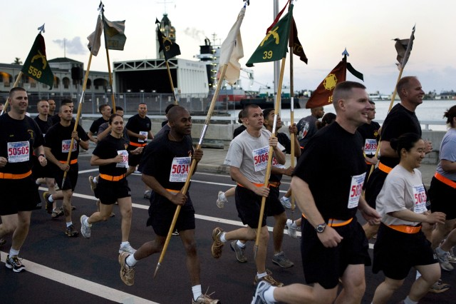 """HONOLULU - As part of the """"Sounds of Freedom,"""" more than 2,500 troops pass by Aloha Tower near the start of 2009's 25th Annual Great Aloha Run. The Great Aloha Run is an 8.15-mile trek along Honolulu harbor from Aloha Tower to Aloha Stadium. The """"Sounds of Freedom"""" features military units running in formation and began in the second year of the run. The charity event benefits Carole Kai Charities, a philanthropic fund run by Hawaii entertainer and GAR co-founder Carole Kai Onouye, and has generated more than $7.6 million for more than 150 nonprofit organizations, including more than $350,000 for military Morale, Welfare, and Recreation organizations."""