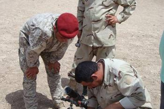 Iraqi mortar soldiers practice referring the sight and the polls on a 60mm mortar system near Amarah, Iraq, Sept. 1, 2009.  The 38th Iraqi Army Brigade soldiers were trained by mortar Soldiers from the 4th Battalion, 6th Infantry Regiment, 4th Bde., 1st Armored Division, deployed to Iraq to advise and assist the Iraqi Army in northern Maysan Province.