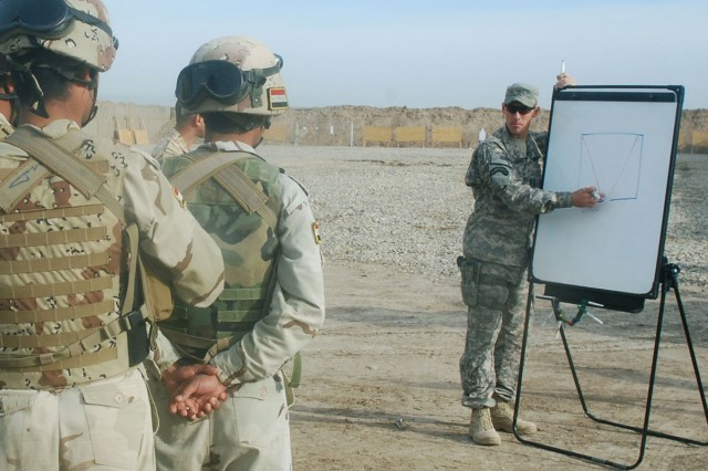 Commandos from the 3rd Battalion, 32nd Iraqi Army Brigade get a block of instruction on the 'Fatal Funnel', a term used to describe doorways, from 1st Sgt. David Eastabrooks, the Troop C, 3rd Squadron, 1st Cavalry Regiment, 3rd Heavy Brigade Combat Team, 3rd Infantry Division's first sergeant, at the Contingency Operating Base Delta training center Feb 12. The training they receive will help them stabilize the elections and train future Iraqi Soldiers.