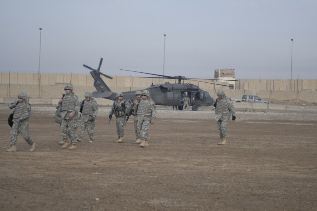 Six of the eight wounded veterans participating in Operation Proper Exit IV exit a UH-60 Black Hawk at Joint Security Station SUJ, located on the northeastern edge of Baghdad, Feb. 2. The Soldiers toured the JSS and spent time talking with Soldiers stationed there.