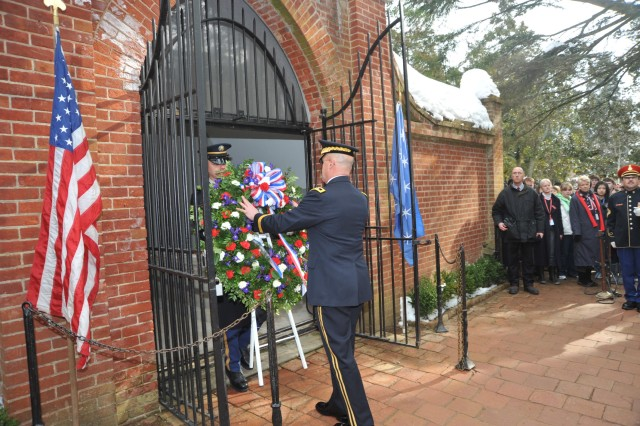 Sgt. Benjamin Sprague assists as Maj. Gen. Karl Horst, commander, Joint Force Headquarters/ National Capital Region and the U.S. Army Military District of Washington, places the Presidential wreath at George Washington's tomb in Mount Vernon, Va.  Feb. 15, 2010