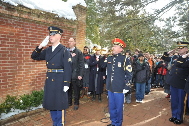 U.S. Army Band bugler, Master Sgt. Allyn Van Patten, plays Taps at the presentation of the Presidential wreath at George Washington's tomb in Mount Vernon, Va. February 15, 2010.