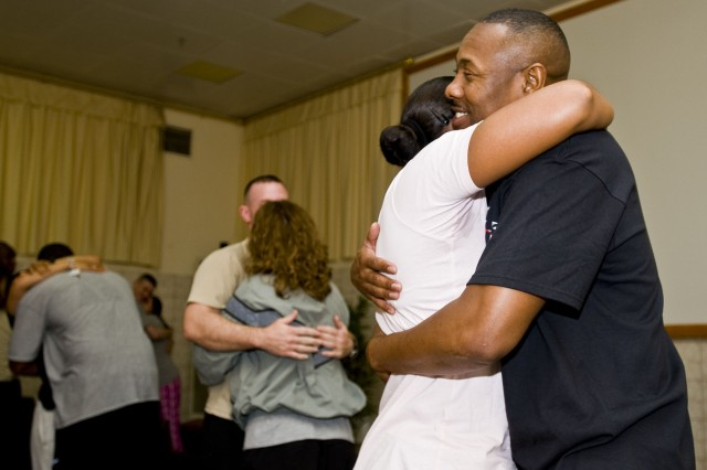 Sgt. Maj. John Johnson, the senior enlisted advisor for Command Post South, hugs his wife, Master Sgt. Cynthia Johnson with HHC 26th BSB, 2nd BCT, 3rd Inf. Div., during a marriage retreat on COB Speicher from Feb 10-12. The marriage retreat was intended to bring married couples closer together to ensure they are more focused on their jobs as Soldiers.