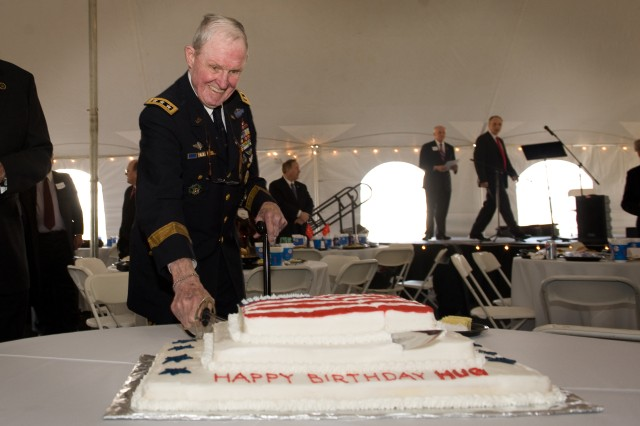 Army Lt. Gen. Harold Moore, ret., cuts a cake that was presented to him in honor of his 88th birthday in Montevallo AL, Feb. 15, 2010.  Moore is a recipient of the Distinguished Service Cross, which is the second highest military decoration and is best known as the Lt. Col. in command of the 1st Battalion, 7th Cavalry Regiment, at the Battle of Ia Drang, in 1965 during the Vietnam War.  US Army photo by D. Myles Cullen