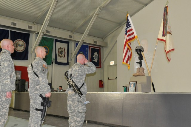 Members of Multi-National Battle Group - East, Kosovo Forces 12, render final honors to Sgt. Terry L. Rishling, Fargo, N.D., during a memorial ceremony at Camp Bondsteel, Kosovo. Rishling died Feb. 11 while deployed with Multi-National Battle Group - East, Kosovo Forces 12, on a NATO peacekeeping mission.