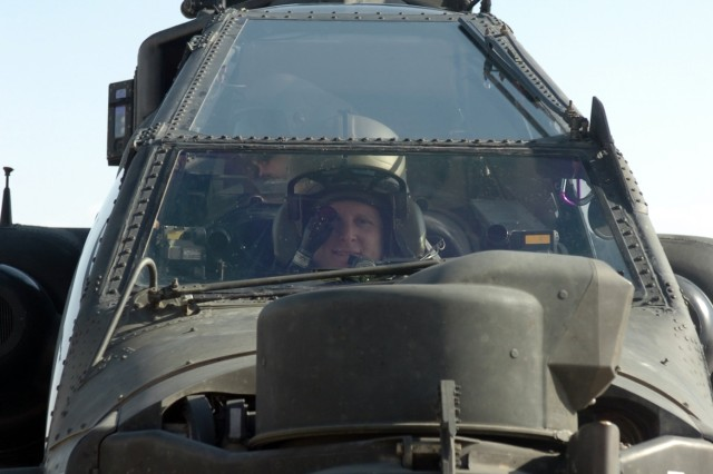 CAMP TAJI, Iraq - Looking out of the front window of an AH-64D Apache attack helicopter, Spc. Michael Moye, an Apache crew chief for Company A, 4th Battalion, 227th Aviation Regiment, 1st Air Cavalry Brigade, 1st Cavalry Division, U.S. Division-Center, prepares to fly in the front seat of the aircraft Jan. 25.