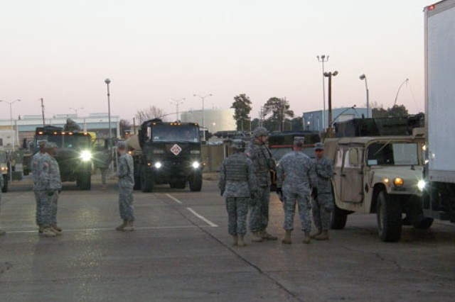 Soldiers perform last minute checks in the predawn light of Jan. 25 as 7th Chem Co prepares to convoy to Pine Bluff Ark. for crew cerification training.