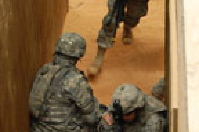 Sgt. Brandon Hendrix (left foreground) and Sgt. Alex Echavarria (right foreground) provide security while Spc. Jimmy Freeman enters a room during a building clearing demonstration Feb. 9 at Peason Ridge. All three Soldiers are members of 7th Chem Co.
