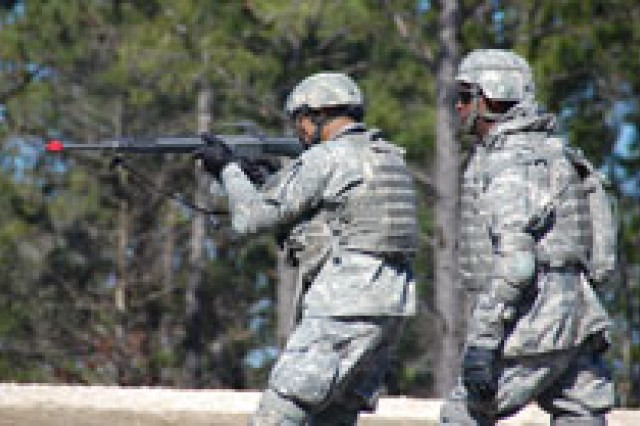1st Lt. Ernest Terry (left), Headquarters and Headquarters Detachment, 83rd Chem Bn, 48th Chem Bde, engages a target during a live fire exercise Feb. 9 at Peason Ridge as Sgt. Daou Bryant, 7th Chem Co, provides instruction.