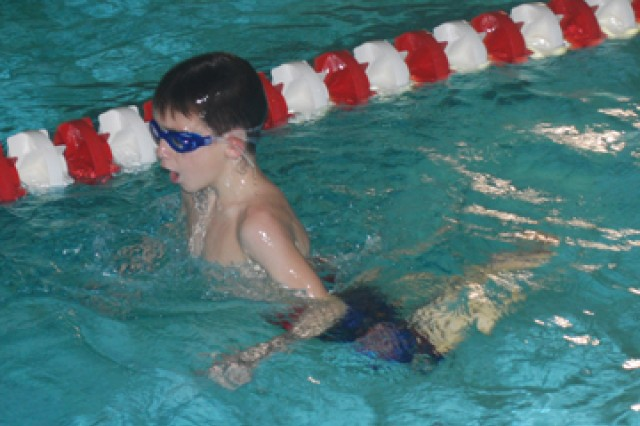 Gabriel Smith, 7, swims laps during the Fort Polk youth swim team's practice Dec. 8. The team practices Tuesdays, Thursdays and Saturdays at the South Fort 50-meter pool.