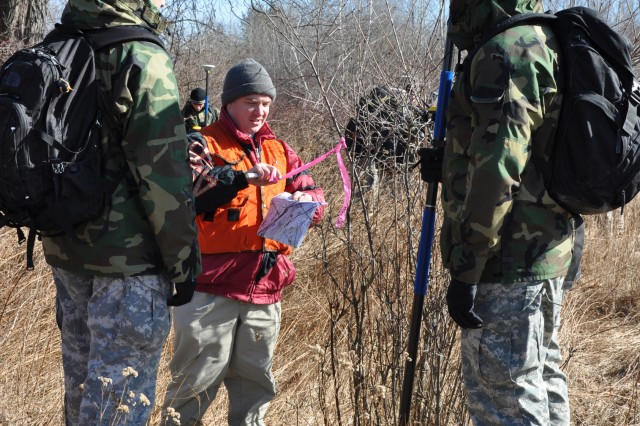 Brian Orzel of New York District's Regulatory Branch works with West Point cadets as he delineates wetlands in Otisville, N.Y. The spot was marked with a pink flag and with GPS devices so the data could be used later.