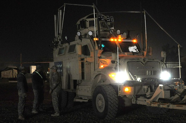 JOINT BASE BALAD, Iraq - Soldiers with the 15th Sustainment Brigade's personal security detail prepare their Mine-Resistant Ambush-Protected vehicles for a mission during the early morning hours of Jan. 27 at Joint Base Balad. (U.S. Army photo by Staff Sgt. Rob Strain, 15th Sustainment Brigade Public Affairs)